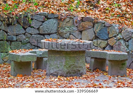 A granite round table in Alexandria park in Belaya Tserkov, Ukraine - stock photo