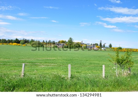 A grass farm with beautiful view