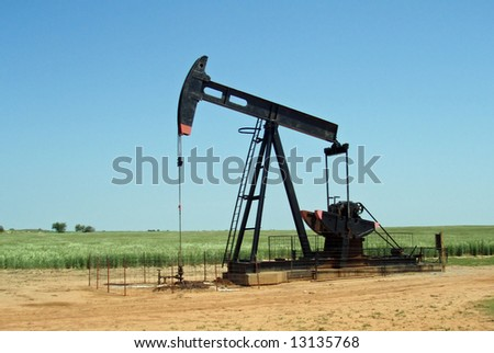 A grasshopper pump pumping oil from the ground - stock photo