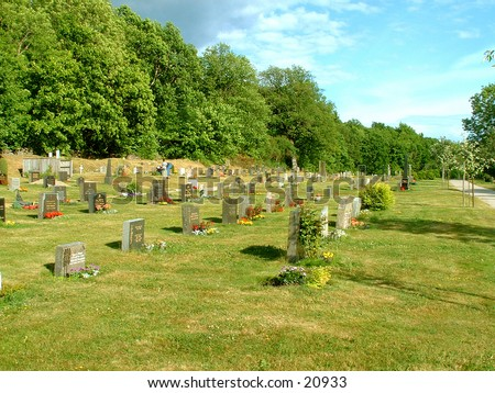 A graveyard at a country church in Norway - stock photo