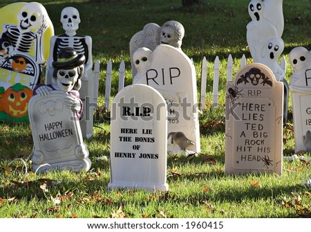 A graveyard decorating a lawn for Halloween. - stock photo