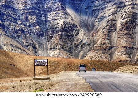 "A gravity hill where slow speed cars are drawn against gravity is famously known as ""Magnetic Hill"" , a natural wonder at Leh, Ladakh, Jammu and Kashmir, India - stock photo"