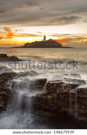 A great evening in Cornwall overlooking a Lighthouse in Cornwall, England, UK - stock photo