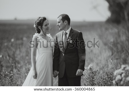a great pair of lovers just married newlyweds on a yellow field