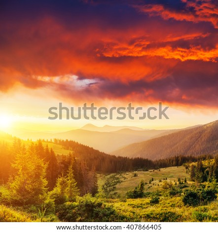 A great view of the hills glowing by sunlight at twilight. Dramatic and picturesque morning scene. Cloudy red sky. Location place: Carpathian, Ukraine, Europe. Beauty world. Warm toning effect. - stock photo