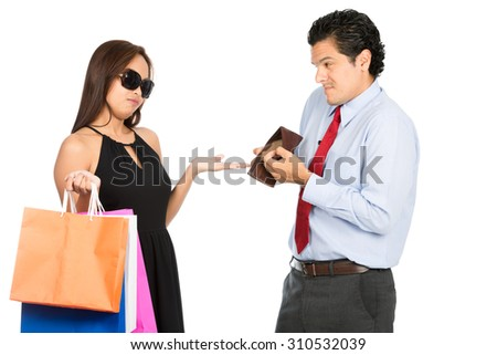 A greedy shopaholic gold digger stylish Asian wife demanding money for shopping from her poor sympathetic husband showing his empty wallet with no cash. Half H - stock photo