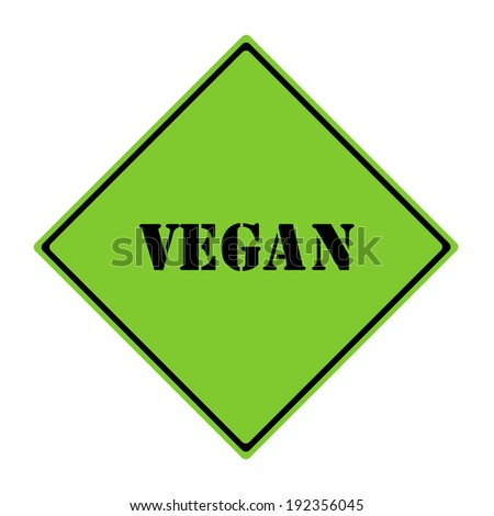 A green and black diamond shaped road sign with the word VEGAN making a great concept.