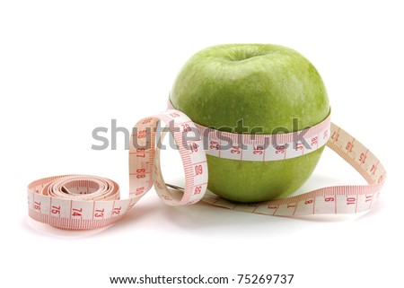 A green apple and a measurement tape - stock photo