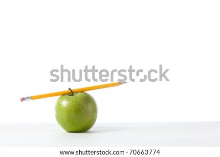 A Green Apple isolated on write with a pencil - stock photo