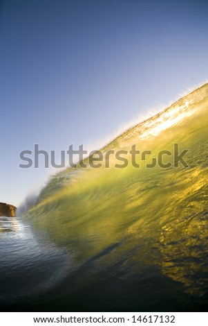 A Green Barrel breaking in the Ocean (Plenty of Copy Space) - stock photo