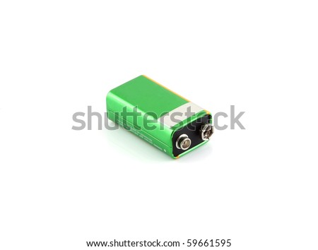 A green battery on a white background. - stock photo