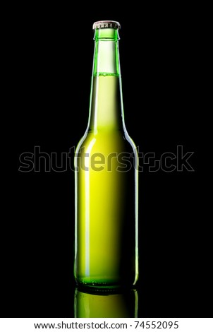 a green bottle beer on a black background - stock photo