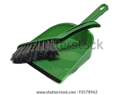 A green brush and dustpan isolated on white background - stock photo
