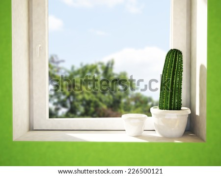 a green cactus on the windowsill - stock photo