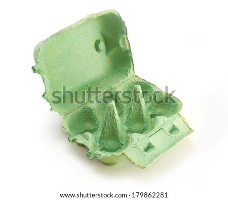 A green empty egg box on a white background. - stock photo