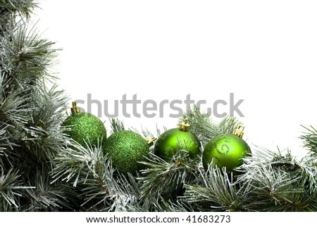 A green garland border with Christmas balls isolated on a white background - stock photo