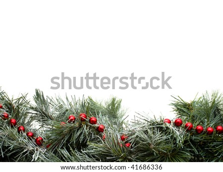 A green garland border with red strung beads isolated on a white background - stock photo