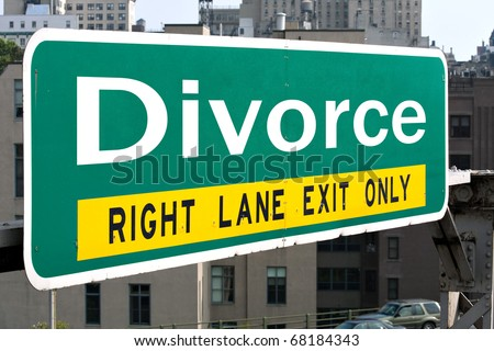A green highway sign with the word Divorce in white letters. - stock photo