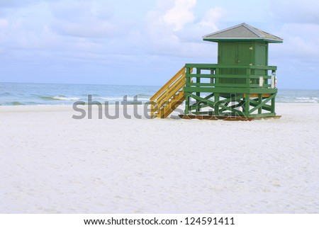A green lifeguard hut on an empty morning beach - stock photo