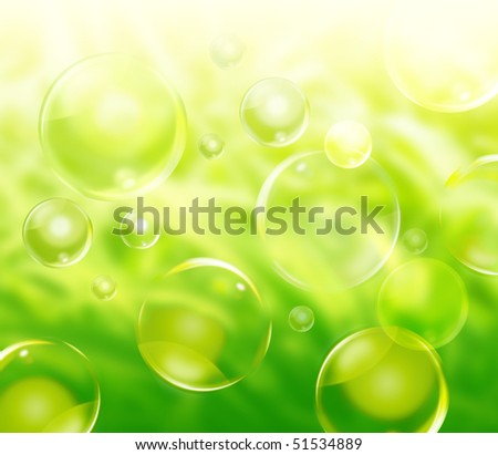 A green natural abstract background with plants in the distance blurred and bubbles floating in various sizes. - stock photo