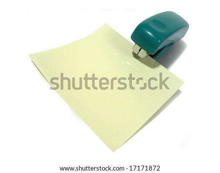 A green office stapler with blank note paper on a white background - stock photo