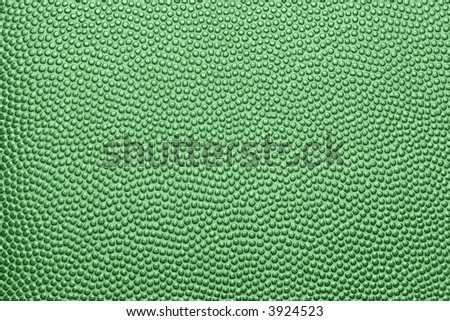 A green pebble-grained texture background