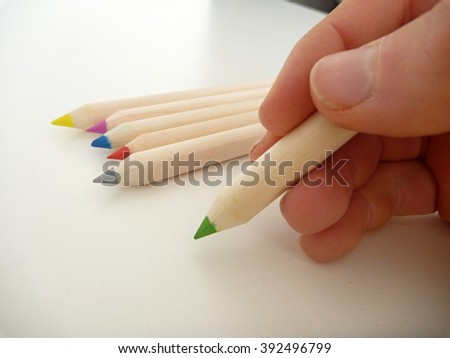 a green pencil in a hand writing - stock photo
