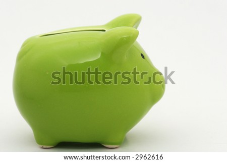 A green piggy bank isolated on white background, shot  from the side - stock photo