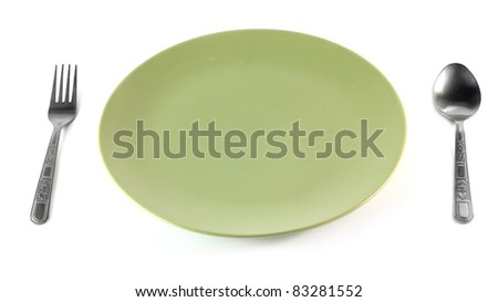 A green plate with a spoon. on white background - stock photo