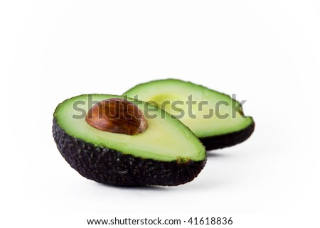 A green ripe avocado cut in half with clipping path