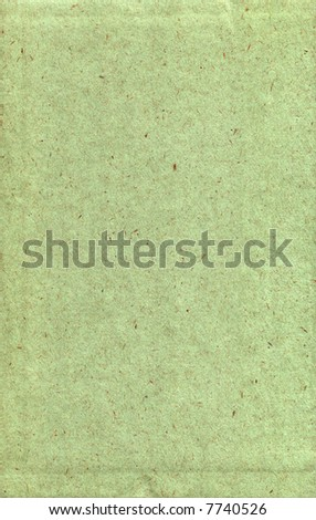A green sheet of textured paper, suitable as a background texture. - stock photo