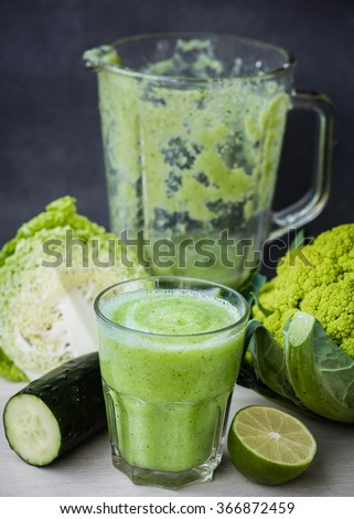A green smoothie made with cabbage, lime,cucumber - stock photo