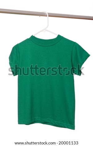 A green t-shirt on a hanger on a white background with copy space - stock photo