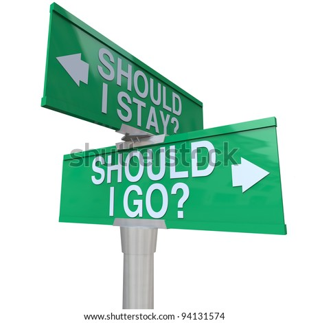 A green two-way street sign pointing to Should I stay or Should I Go with arrows pointing to left or right to compare options - stock photo