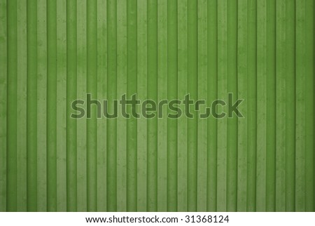 A green wooden wall background - stock photo