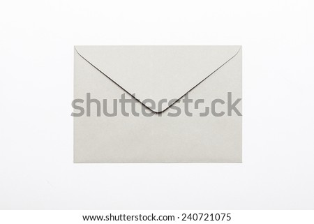 A grey envelope isolated white, top view at the studio. - stock photo