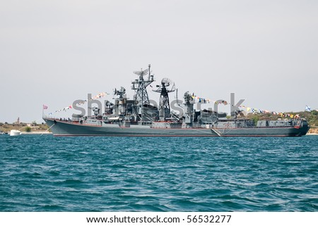 A grey navy warship anchored at sea - stock photo