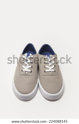 A grey sneakers top side view isolated white.