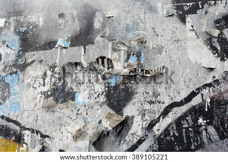 a grey torn posters and spraypaint background - stock photo