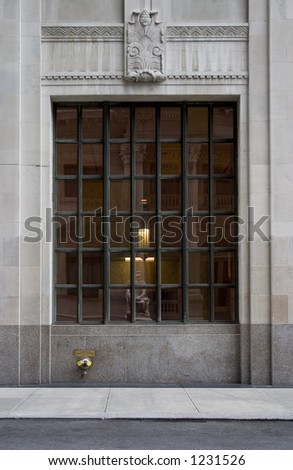 A grid window on a neoclassical building in New York City.