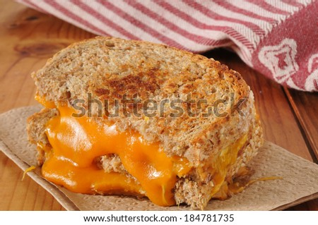 a grilled cheese sandwich on whole grain bread - stock photo