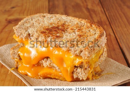 A grilled cheese sandwich on whole wheat bread - stock photo