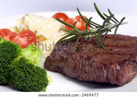 A grilled top sirloin steak .. medium with broccoli and fresh pasta - stock photo
