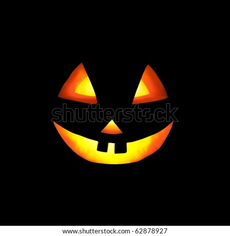 A Grinning Jack O Lantern Against a Dark Background - stock photo