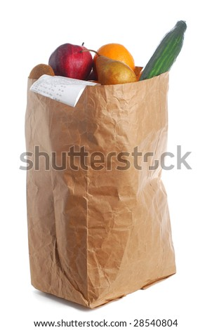 A grocery bag full of groceries with bill hanging out - stock photo