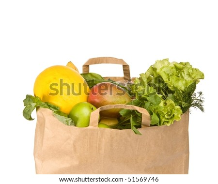A grocery bag full of healthy fruits