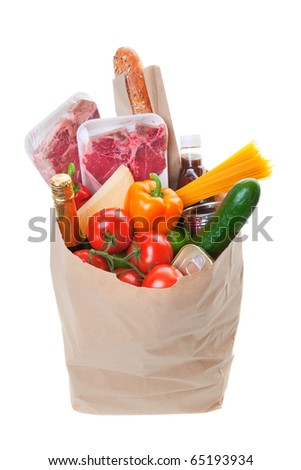 A grocery bag full of Meat with healthy fruits and vegetables
