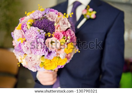 A groom with a bouquet bride - stock photo