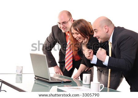 A group celebrating around a computer - stock photo
