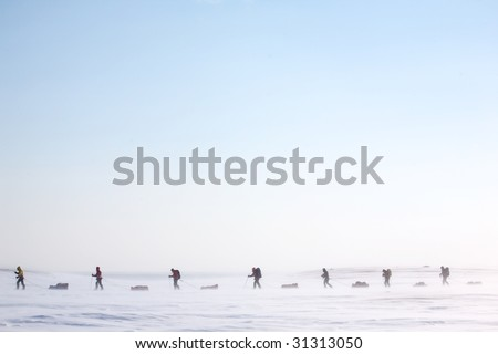 A group of adventurers on a arctic expedition - stock photo